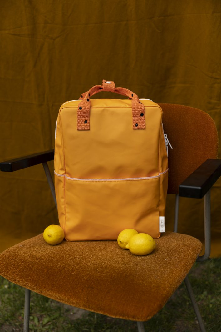 1801644 – Sticky Lemon – backpack large – freckles – sunny yellow + carrot orange – style shot 0